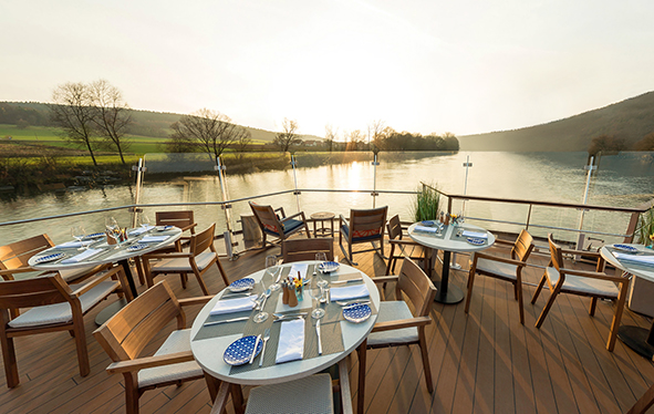 Longship's Aquavit Terrace on the river at sunset
