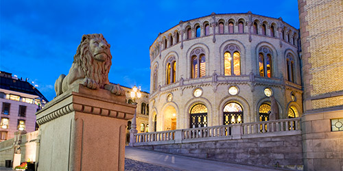 Oslo Parliament Lion Statue at dusk.