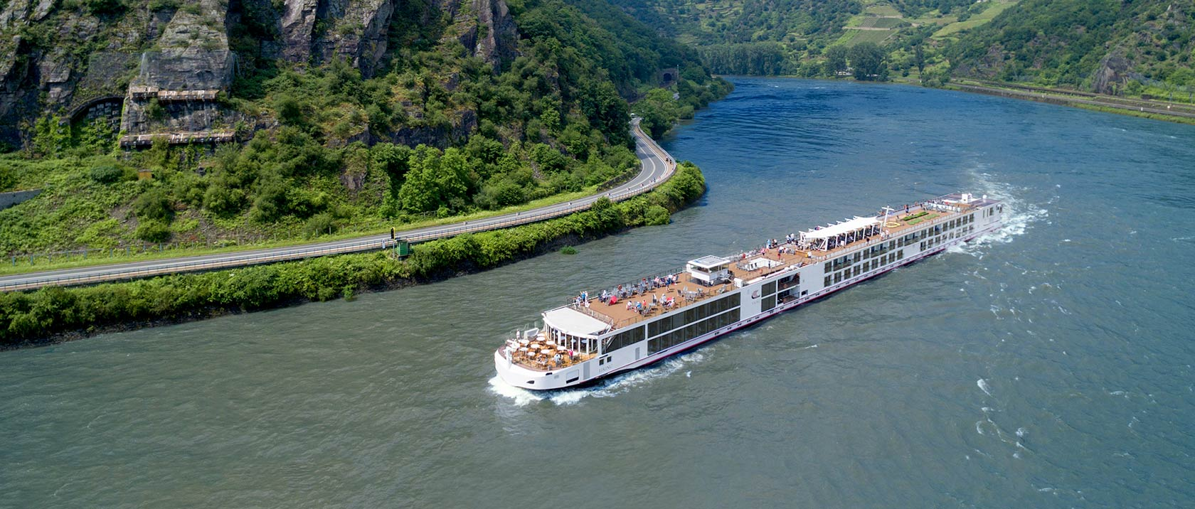 A Viking river ship sailing along the Middle Rhine river
