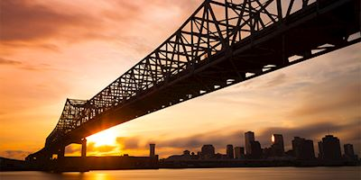 New Orleans skyline and bridge at dusk