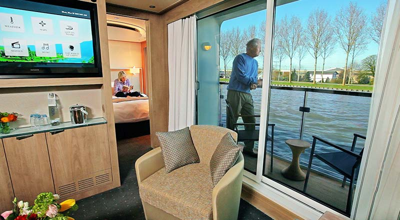 Man looking out from the veranda of a Viking river ship stateroom